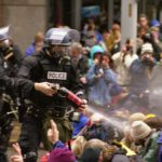 Seattle police spray protesters (Steve Kaiser/Wikimedia)