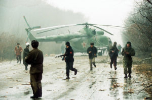 Russian soldiers in Chechnya with downed helicopter. (photo: Mikhail Evstafiev)