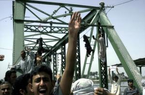 Bodies of US contractors hang from a Fallujah bridge (photo: AP/ Khalid Mohammed)