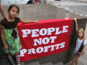People Not Profits banner (cc photo: edenpictures)