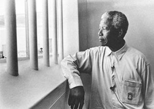 Nelson Mandela in prison. He was released in 1990, after being incarcerated for 27 years.   http://www.dailyhistory.net