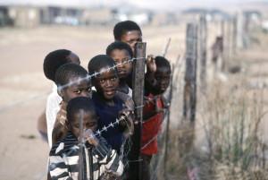 """Children in a """"resettlement"""" village in apartheid South Africa. (cc photo: UN)"""