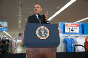 Obama giving speech on clean energy at a Walmart store