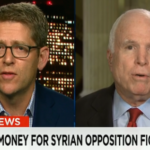 Debate, corporate media style:  Two pro-war guests go at it.