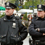 NYPD officers in Greeley Square (cc photo: Torbakhopper)