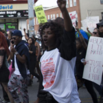 Baltimore protesters (photo: John Taggart/EPA)