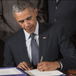 Obama signing Fast Track (Photo SAUL LOEB/AFP/Getty Images)