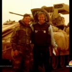 Brian Williams with a U.S. soldier in Iraq.