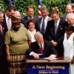 "Bill Clinton signing the ""welfare reform"" bill"