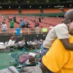 Katrina survivors in the Astrodome (photo: Andrea Booher/FEMA)