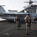 US Navy pilots on an aircraft carrier (photo: Adam Ferguson/NYT)