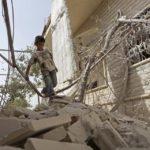 Boy in rubble, Syria