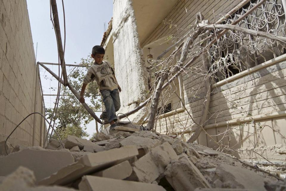 Boy in rubble, Syria