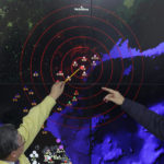 Officials examining a map of North Korean seismic event (photo: Chung Sung-Jun/Getty Images)